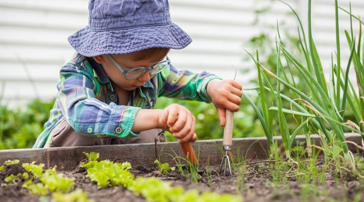 Child Playing in Garden