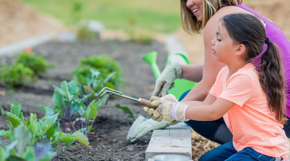 Child Using Gardening Tool